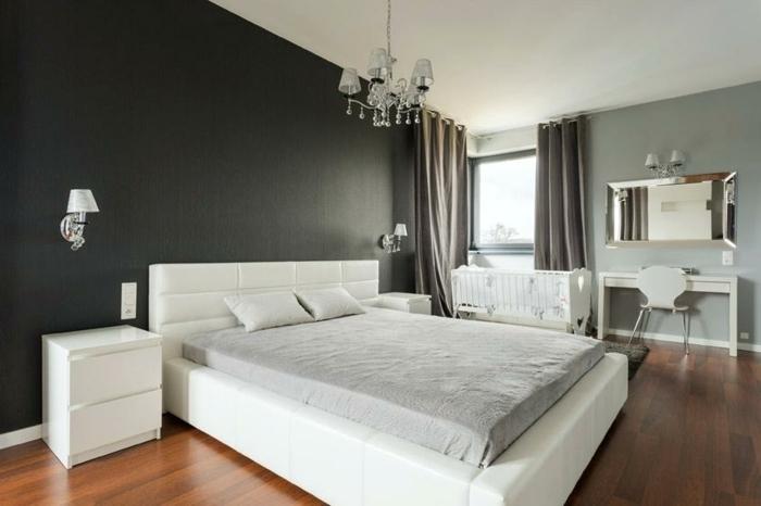 feng shui dormitorio con cama blanca de cuero con paredes en negro y gris con ventanas con cortinas marrones
