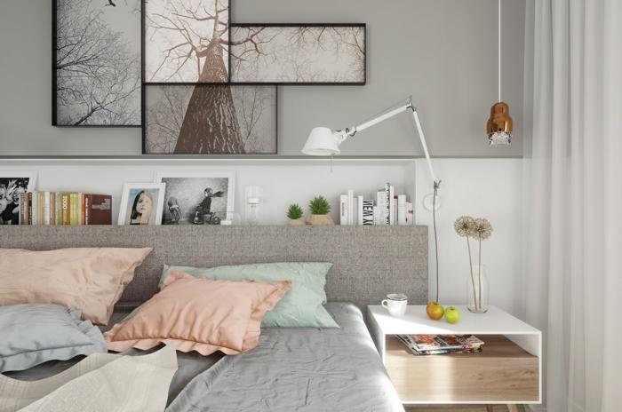 feng shui dormitorio con cama en gris con cojines de diferentes coloeres y cuandros de árboles encima
