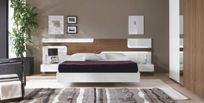 como pintar un dormitorio con paredes en marrón con alfombra de diferenes colores y cama blanca con morado