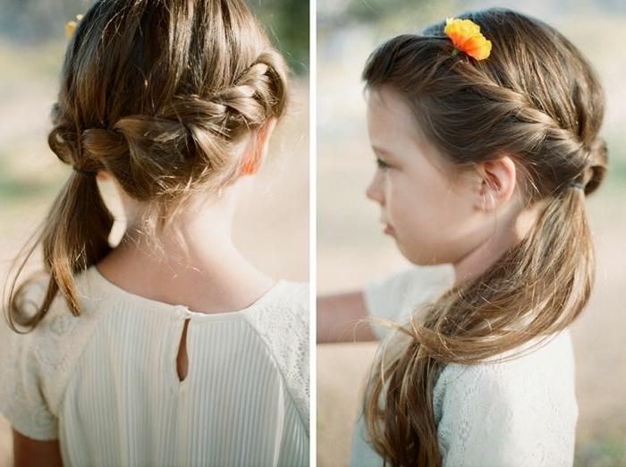 trenzas faciles, niña con una coleta hacia un lado con trenza rodeandole la cabeza decorado con una flor