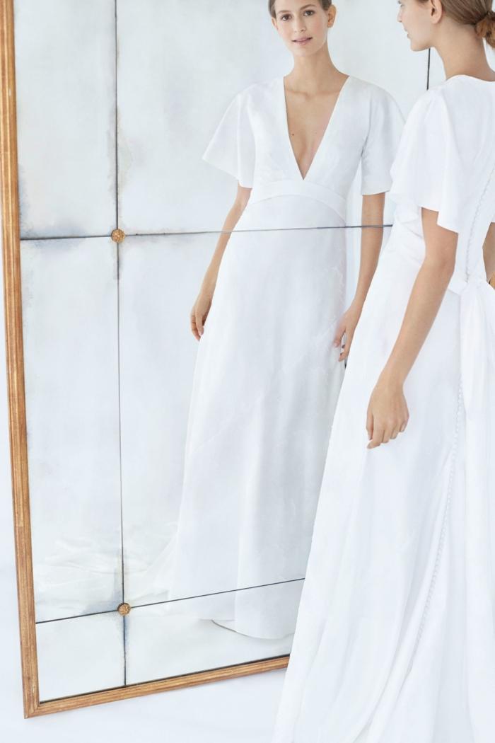 inocencia y feminidad en blanco nuclear, precioso vestido en blanco nuclear con escote en V