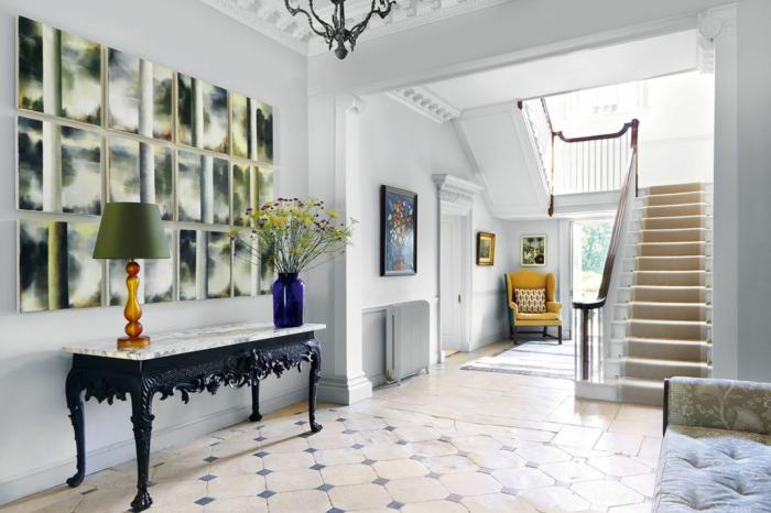 ideas de decoración de recibidores modernos, suelo con azulejos, mesa vintage, pared decorada con encanto