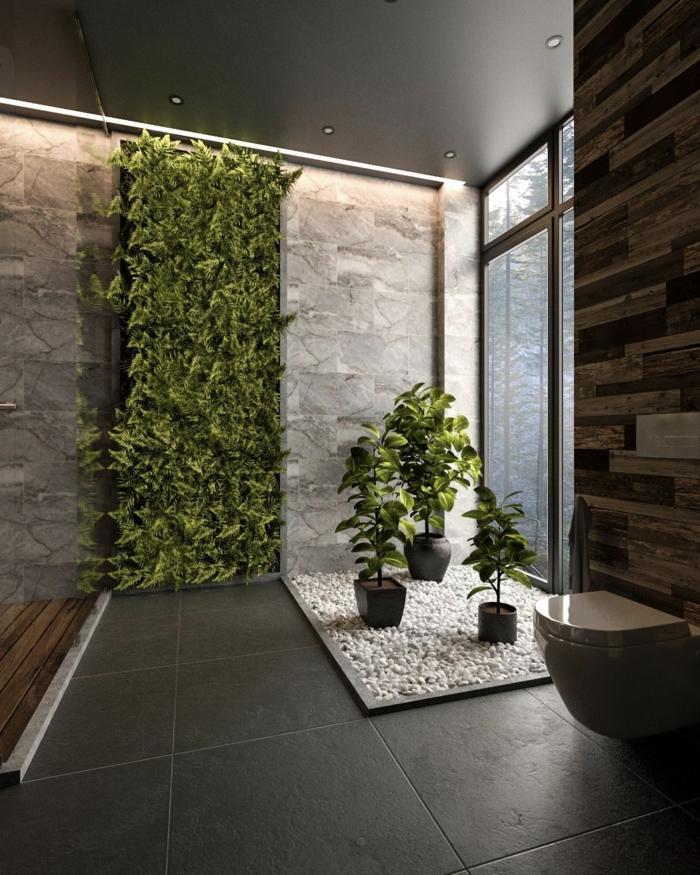 decoración de encanto baño gris y blanco, baldosas en gris oscuro muchas plantas verdes, luces empotradas