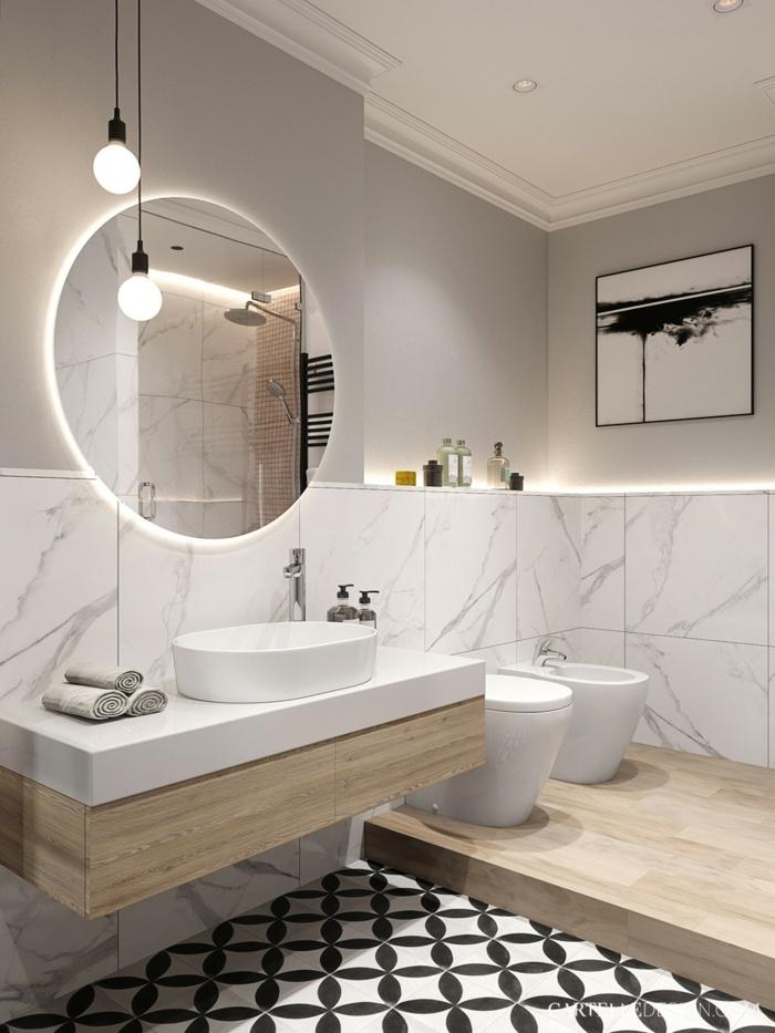 azulejos baños porcelanosa, baldosas de figuras blancas y negras, espejo redondo, detalles de madera