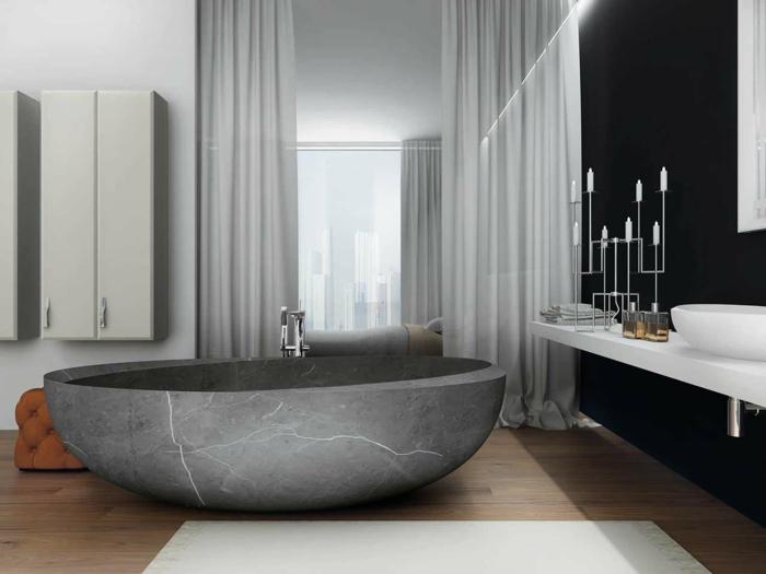 baños grises super modernos, grande bañera de mármol color gris, paredes en blanco y negro, taburete color cobre