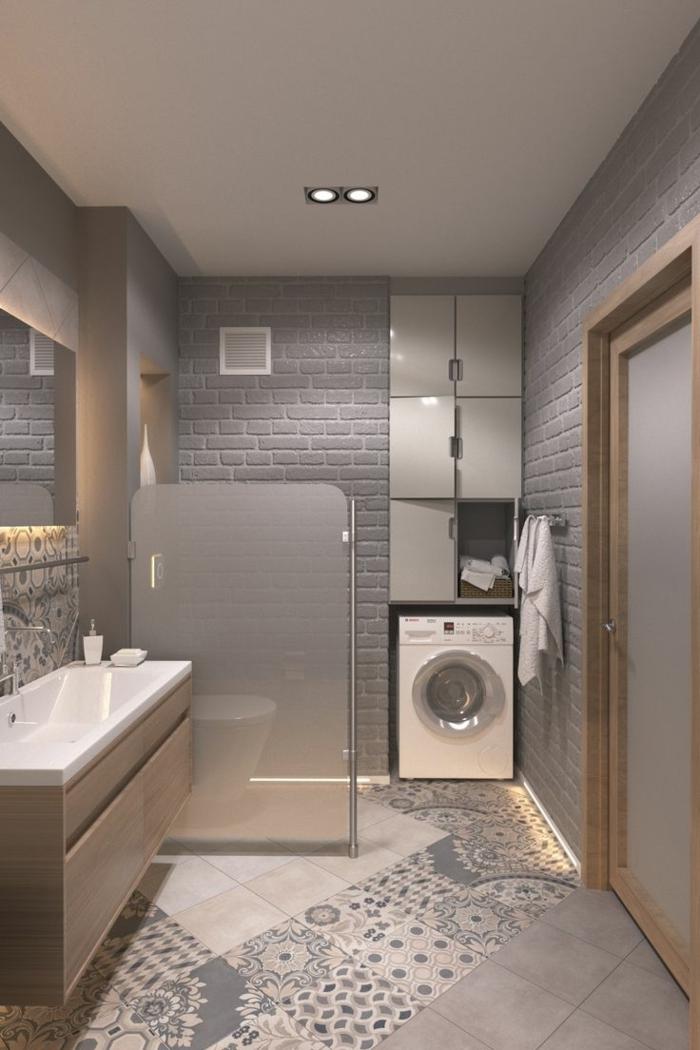 alicatar baño, azulejos de figuras geometricas en colores grises y blancos conjuntadas con baldosas de color beige