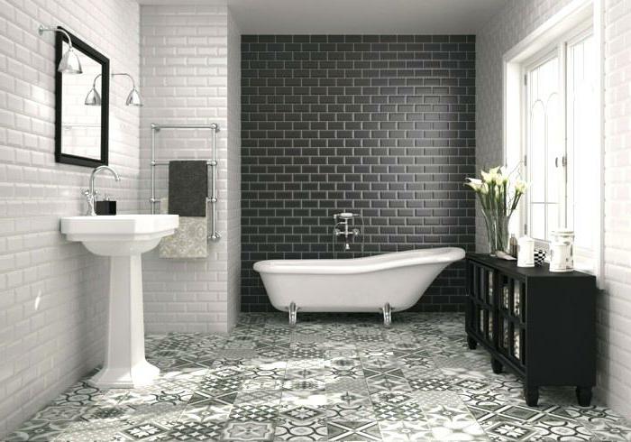 azulejos baños porcelanosa, suelo de baldosas de figuras geométricas y motivos étnicos, paredes blancas y negra