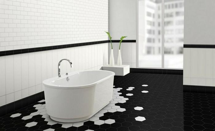 azulejos baños porcelanosa, baldosas hexagonales de color blanco y negro, con bañera de color blanco