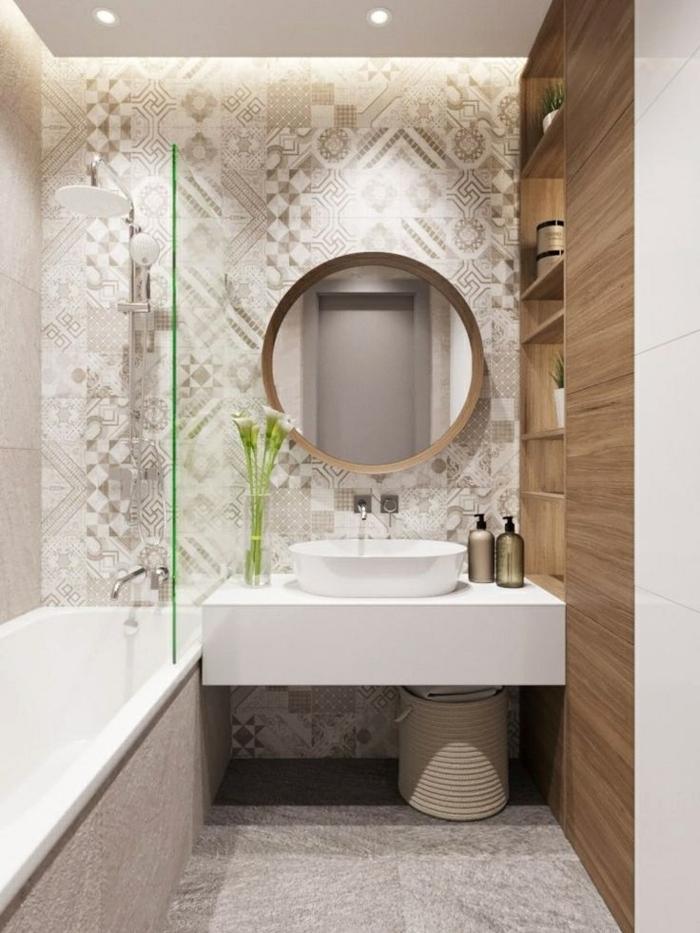 azulejos baños porcelanosa, baldosas de suelo en gris con motivos más claros y oscuros, espejo redondo