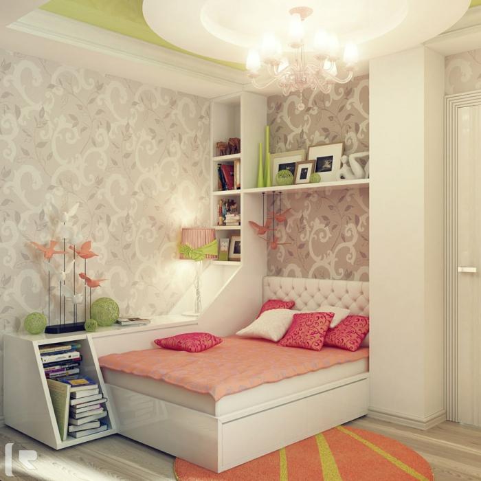 camas compactas juveniles, alfombra redonda en naranja y verde claro con vinilo de color crema en la pared