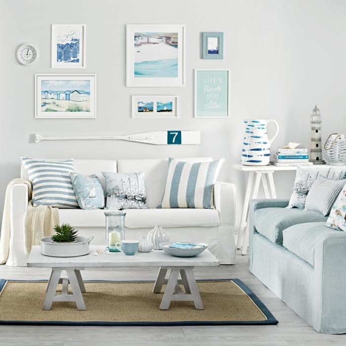 decoracion de pisos sofa de doble asiento, cuadros en la pared en colores blanco y azul, alfombra