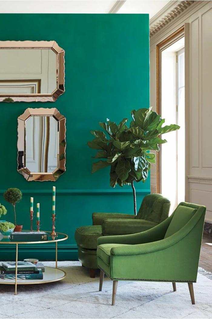 decoracion pisos pequeños, paredes en verde con sillones en verde y con una plata grande al lado
