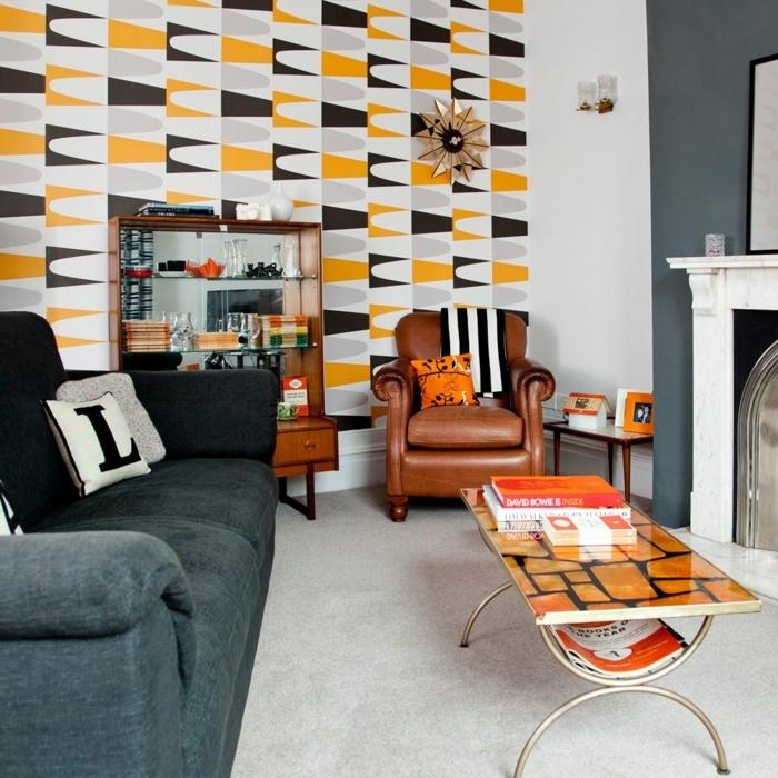 decoracionsalon pequeño, vinilo de colores en amarillo, negro y gris, mesa de salón pequeña