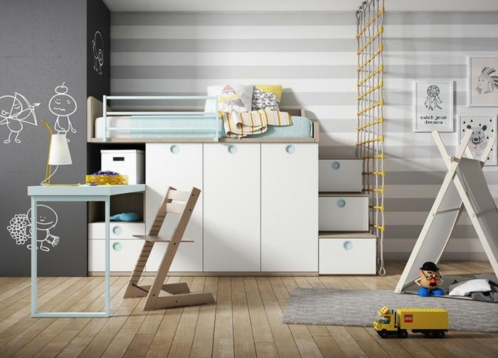 dormitorios infantiles, cama con cajones blancos, alfombra en gris, paredes con vinilo de rayas