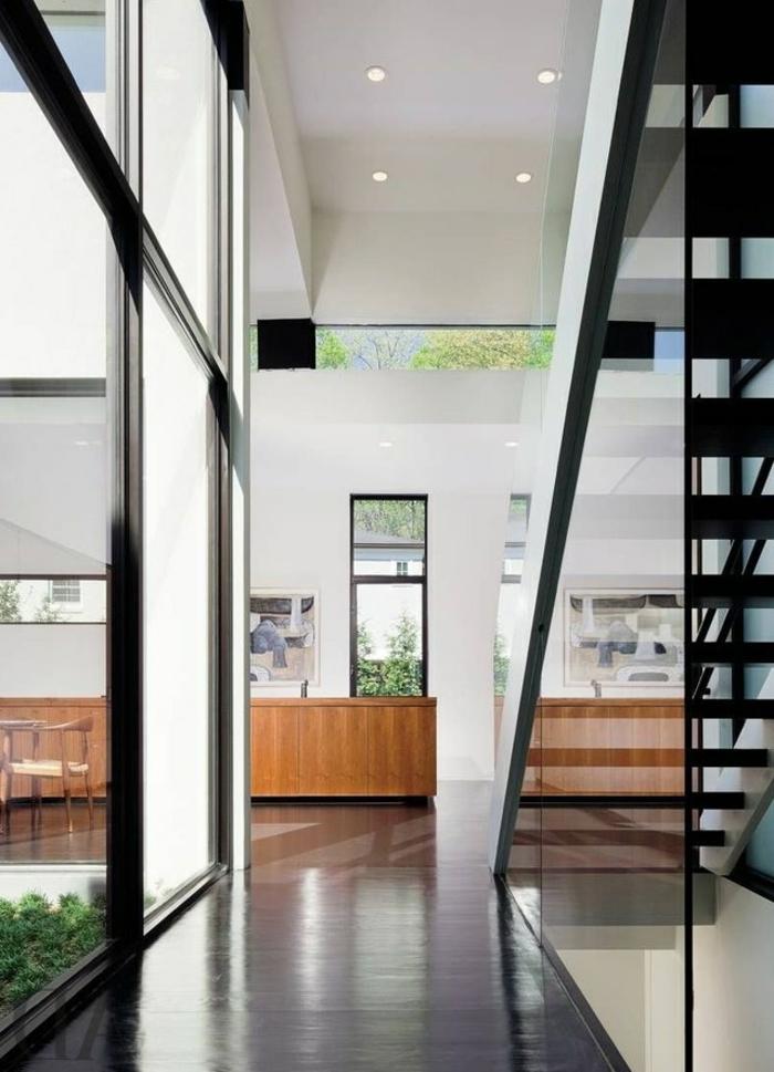 recibidores de casas en estilo contemporáneo, escaleras modernas, techo con luces empotradas