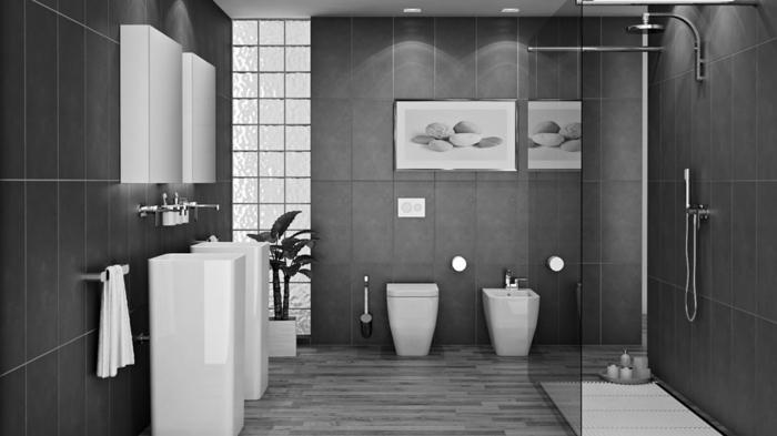 grande baño decorado en gris oscuro y blanco con cuadros decorativos en la pared y suelo de azulejos