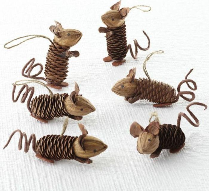 ideas de manualidades infantiles para pequeños y adultos, pequeñas figuras hechas de piñas y nueces