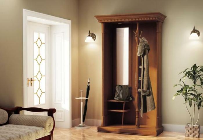 entraditas pequeñas decoradas con mucho estilo, paredes decoradas en beige, suelo de parquet y armario de madera