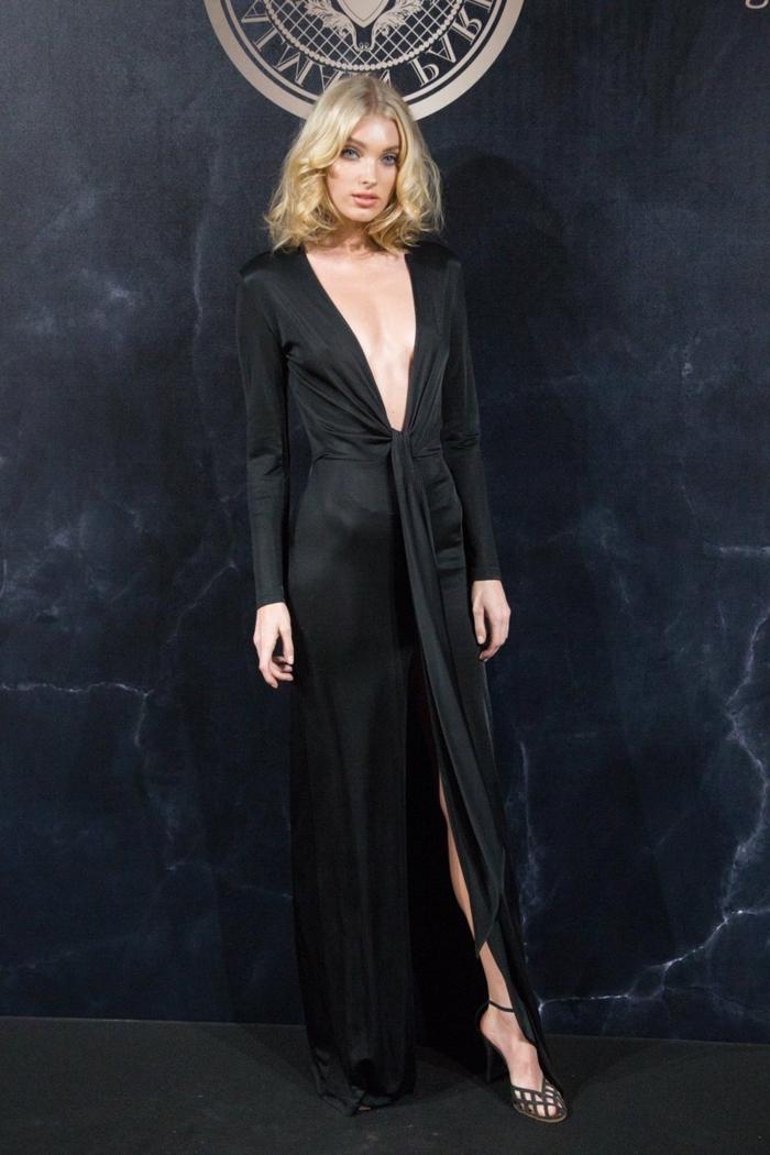 ondas pelo corto, modelo alta con vestido negro largo con mangas largas y escote profundo