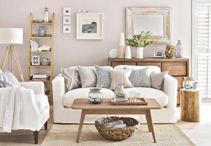 pisos decorados, sofá de doble asiento en blanco con cojines de diferentes colores, espejo en la pared