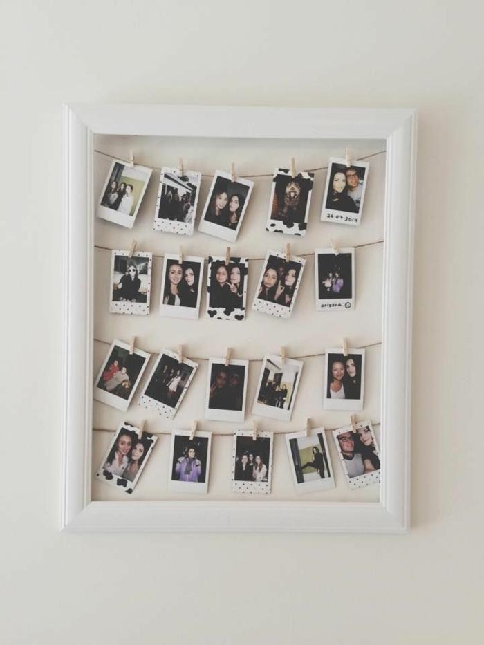 que regalar a una amiga por su cumpleaños, marco blanco con cuerdas y fotos colgadas sobre ella con pinzas