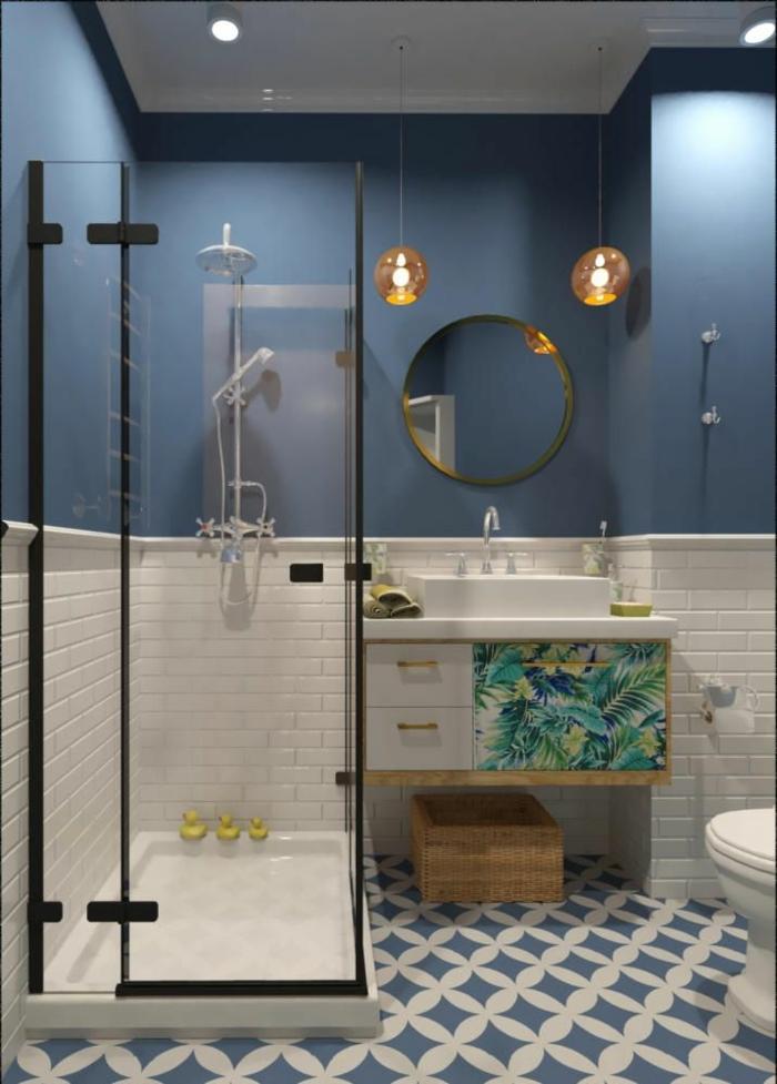 suelos ceramicos, azulejos de color blanco y azul, mitad de la pared pintada de azul osucro, espejo redondo