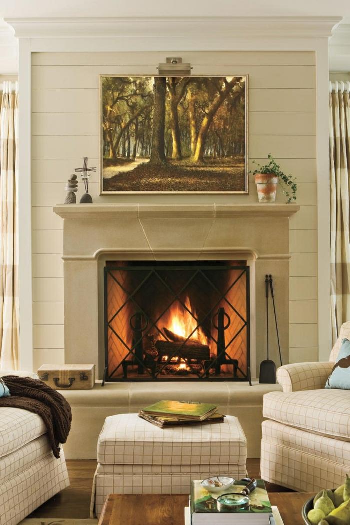 preciosas propuestas chimenea moderna, salón moderno decorado en beige, preciosa pintura en la pared
