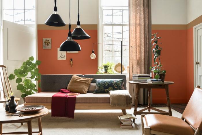 ideas de pintura salon dos colores, salón de diseño con paredes en naranja, beige y blanco, muebles en beige