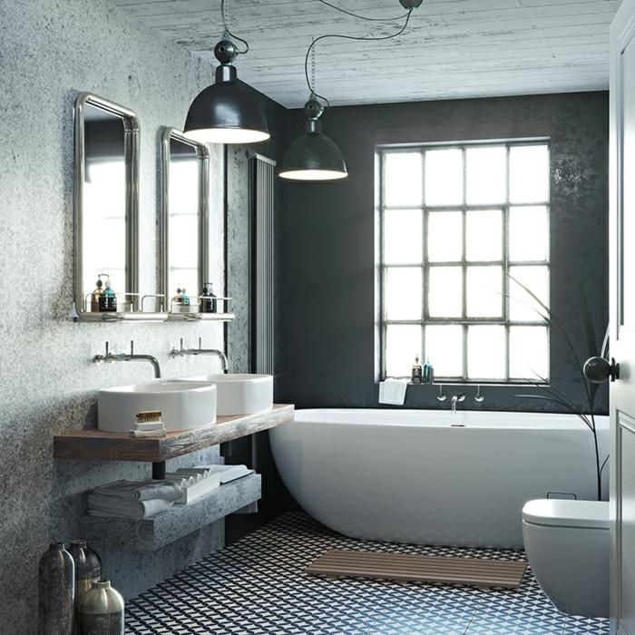 baño en gris decorado en estilo industrial, paredes en gris, suelo con azulejos mozaícos, bañera oval