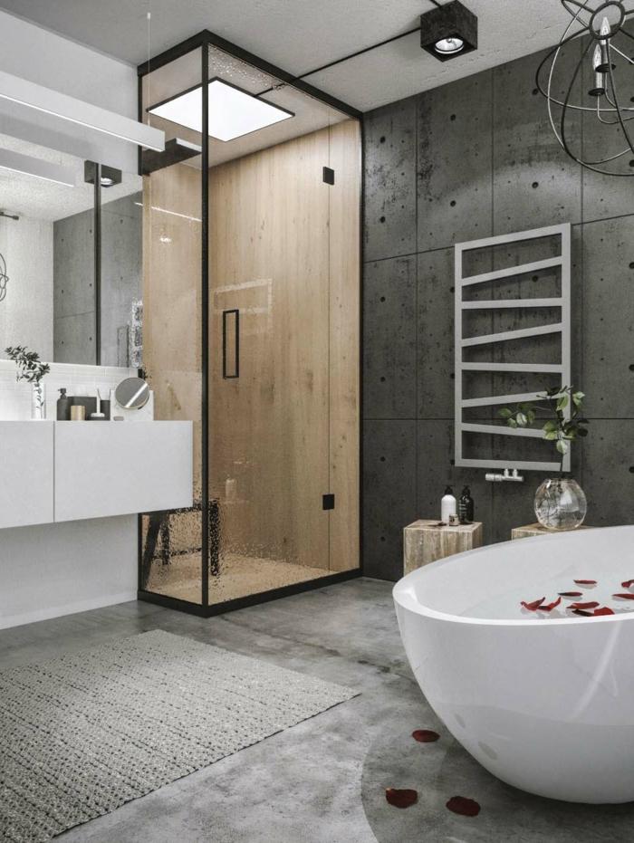 baños grises decorados en estilo industrial, paredes y suelo en gris, bañera moderna oval, cabina de ducha