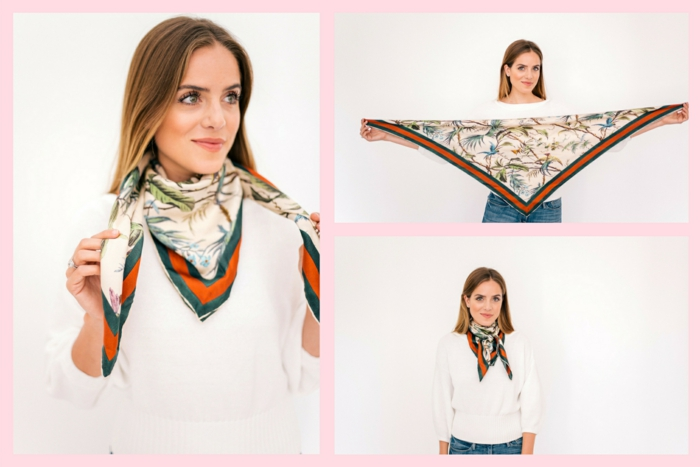 formas de ponerse un fular originales y modernas, mujer con vaqueros, blusa blanca, pañuelo de seda con motivos florales