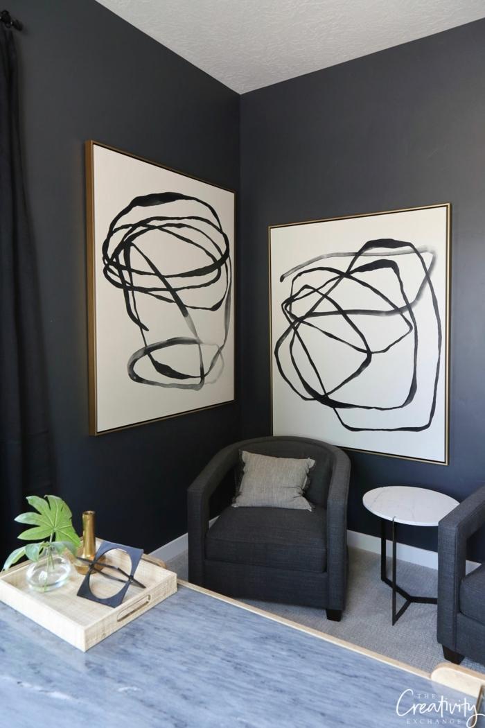 habitaciones pintadas en negro, precioso salón con muebles de diseño y pinturas en la pared