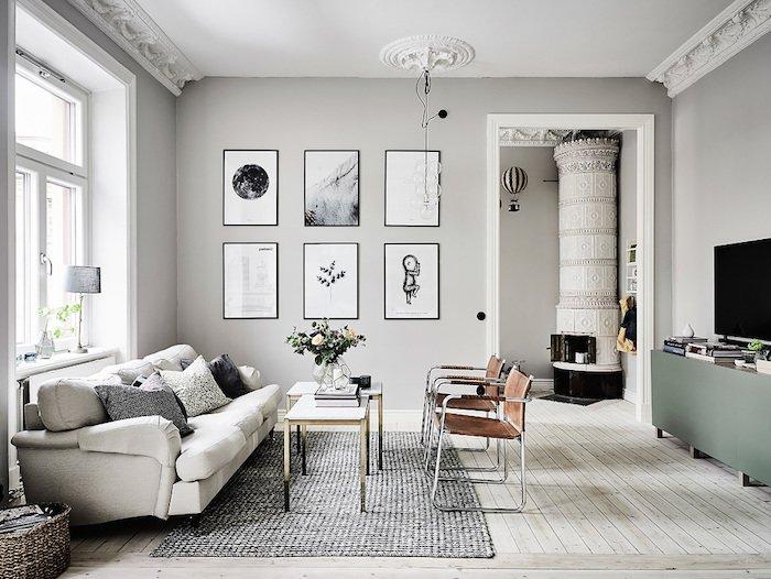 decoración salon gris y blanco con paredes en color gris claro, sofá de diseño sillones, suelo de parquet