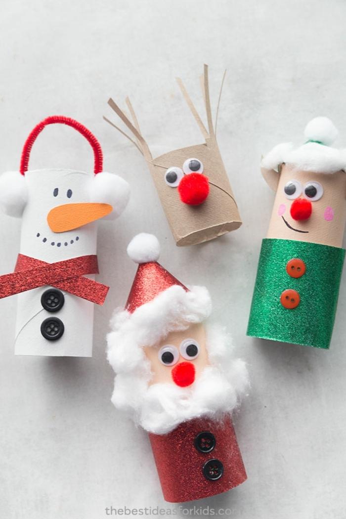 muñequitos navideños hechos de materiales reciclados, tubos de cartón decorados, ideas de adornos navideños fáciles de hacer