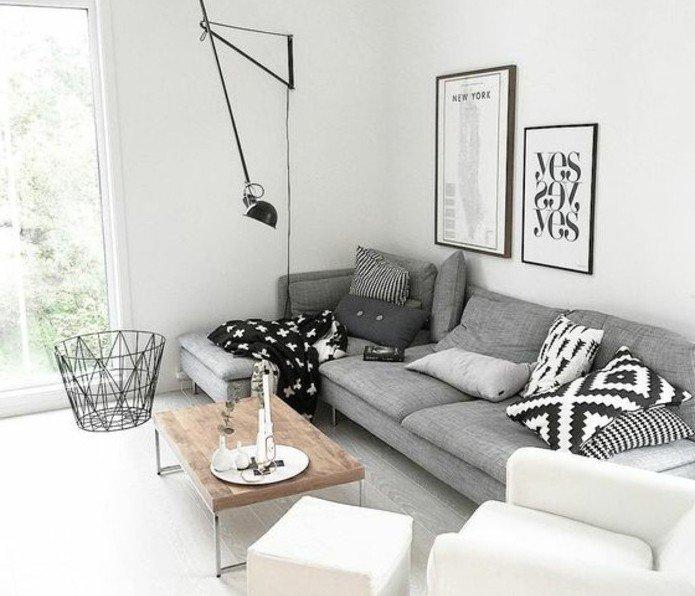habitacion gris y blanca decorada según las últimas tendencias en estilo nórdico, salon decorado de diseño