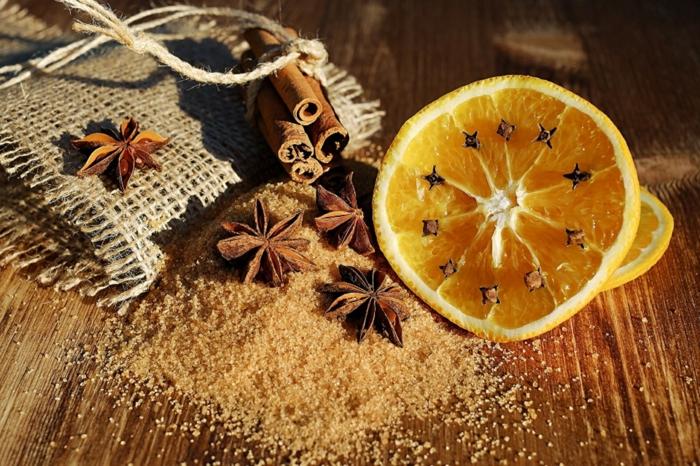 fotos navideñas acogedoras para despertar tu espíritu navideño, azucar morena, canela, naranja