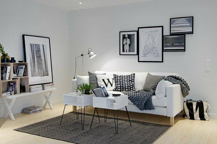 bonitos espacios decorados en estilo contemporáneo, habitación gris y blanca con muchos cuadros