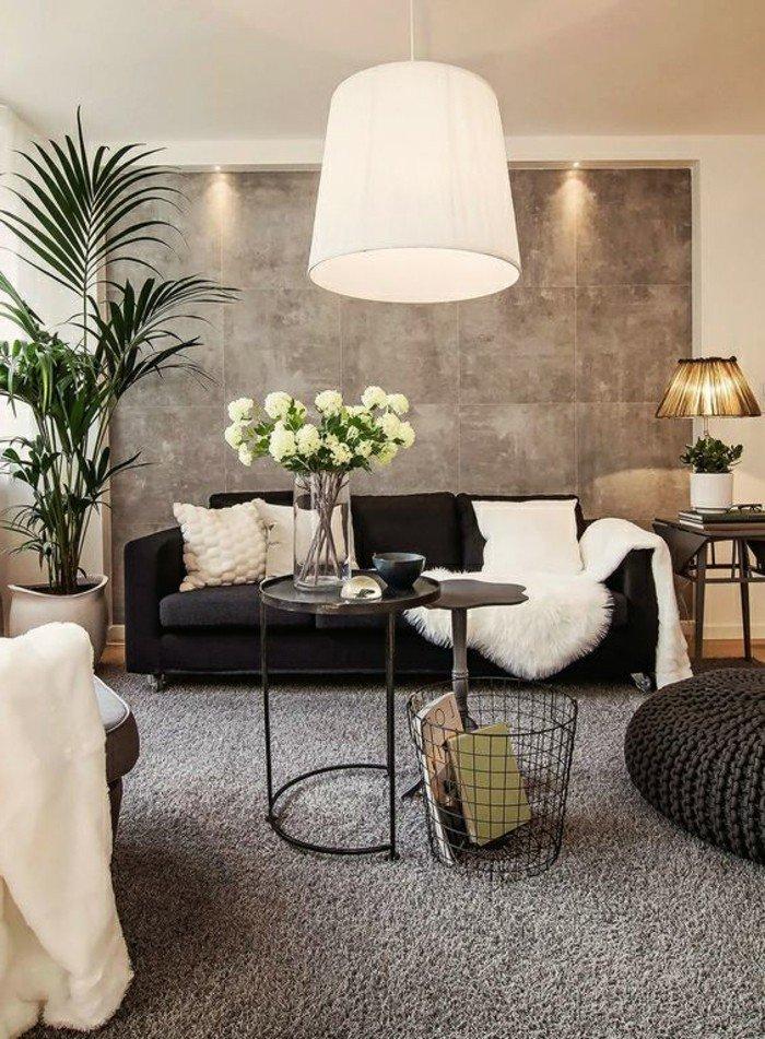 habitación gris y blanca con muchas flores y plantas verdes, luces empotradas, decoración salón moderno