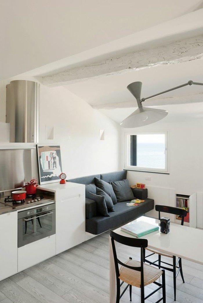 espacios con varias zonas de uso, decoracion de salones pequeños en colores claros, muebles multifuncionales