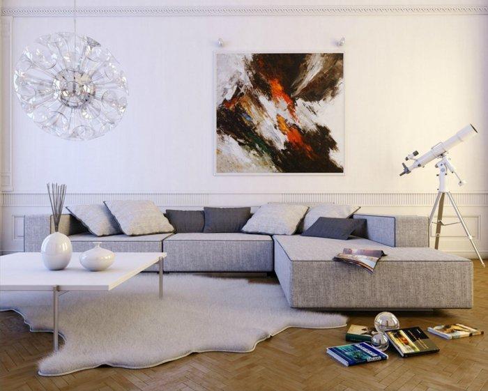 salon gris y blanco en estilo vitnage, alfombra vaca en blanco, sofá en gris claro, pintura en la pared