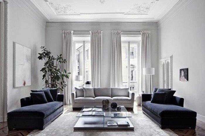 espacios decorados en gris con muebles en gris oscuro, preciosas cortinas y plantas verdes
