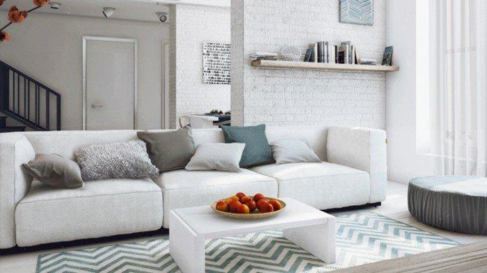 salón con paredes de ladrillo, sofá blanco y alfombra en gris y blanco, mesa pequeña moderna en blanco