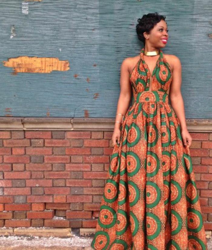 largos vestidos inspirados en la moda bohemia, vestido maxy en naranja y dorado con motivos florales