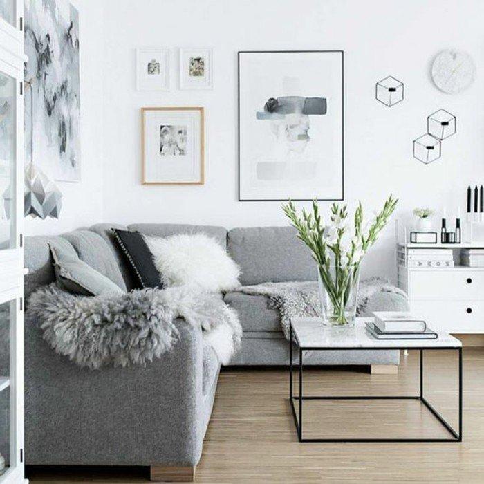 preciosa decoracion de salones grises decorados en estilo escandinavo, cuadros en la pared