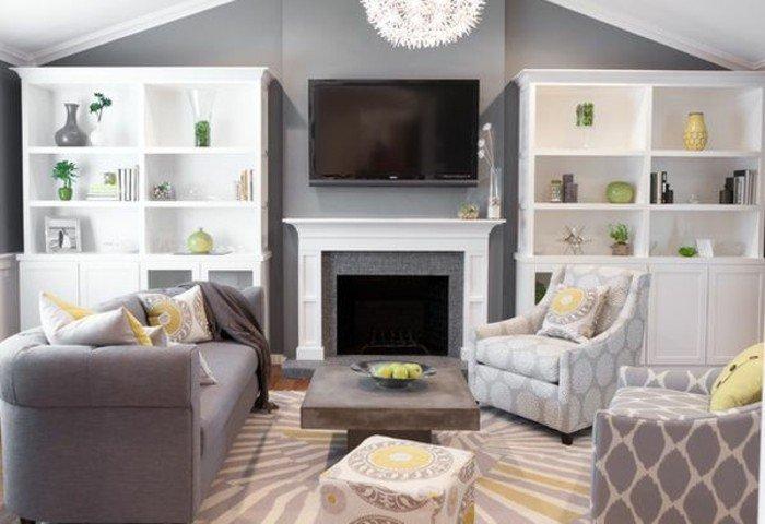 salón moderno con paredes grises, estanterias blancas y muebles de diseño en blanco y muebles modernos