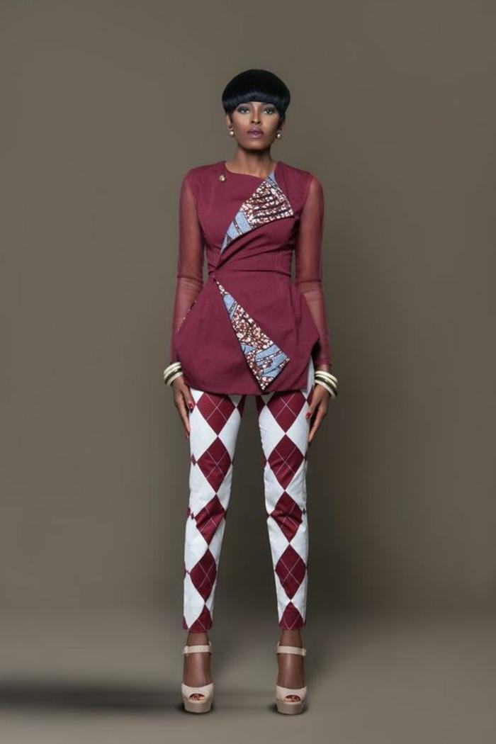 outfit super moderno y elegante, pantalón con motivos geométricos en rojo y blanco parte superior de corte original