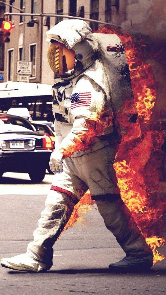 fondos de pantalla para iphone surrealistas, imagines que te ponen a pensar, astronauto en llamas