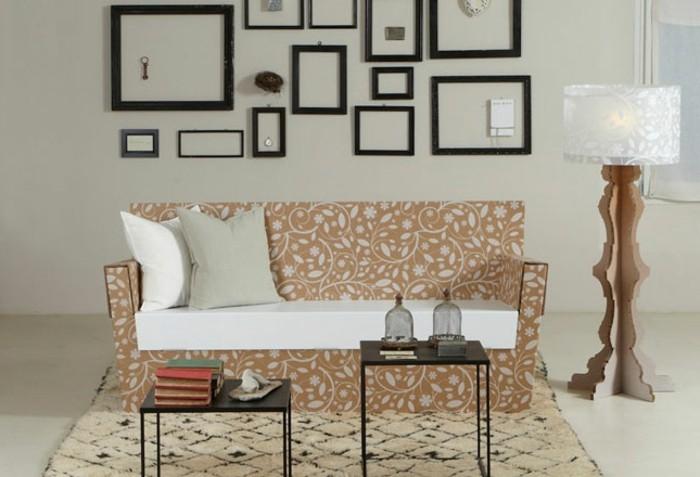 ideas de muebles de carton, salón moderno decorado en blanco y beige con una sofá hecha de cartón