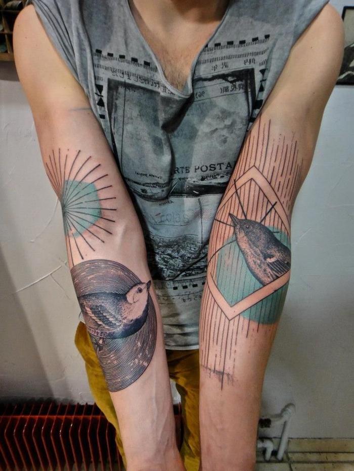 tatuajes geometricos en los antebrazos, tatuajes con pájaros, líneas y figuras geométricas