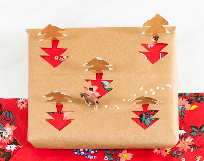 regalos de navidad originales, caja con regalo envuelta en papel decorativo y papel embalaje